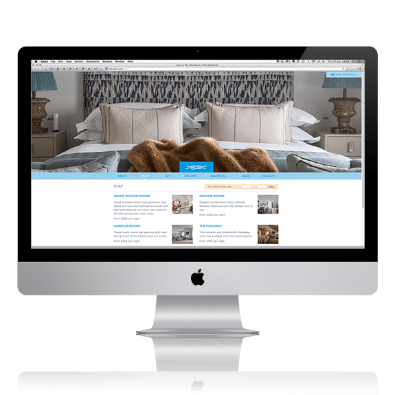 An iMac displaying a website design for the Idle Rocks hotel | Tribus Creative - design services for small businesses