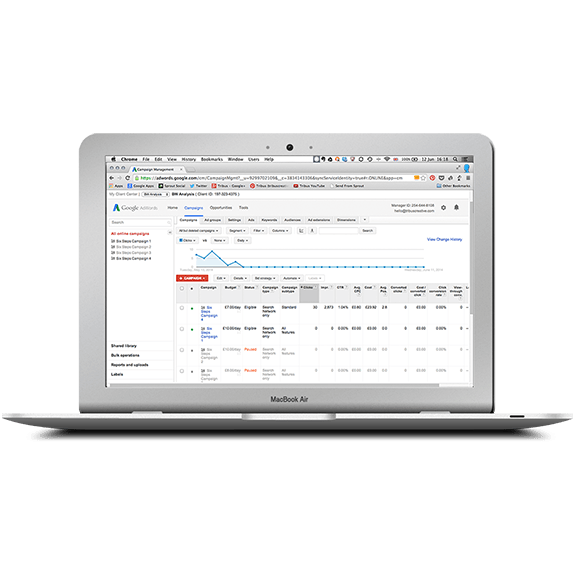 A MacBook laptop displaying the Client Manager interface of Google AdWords | Tribus Creative - marketing for small businesses
